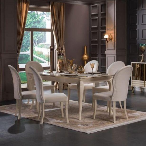ELITE SALLE A MANGER TABLE + 6CHAISES offre à 19210 Dh